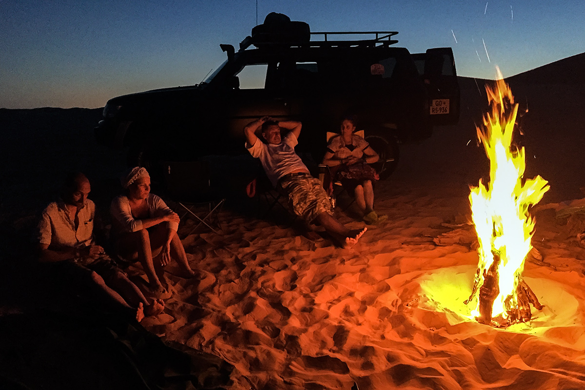 Enjoing the evening in Sahara by the campfire.