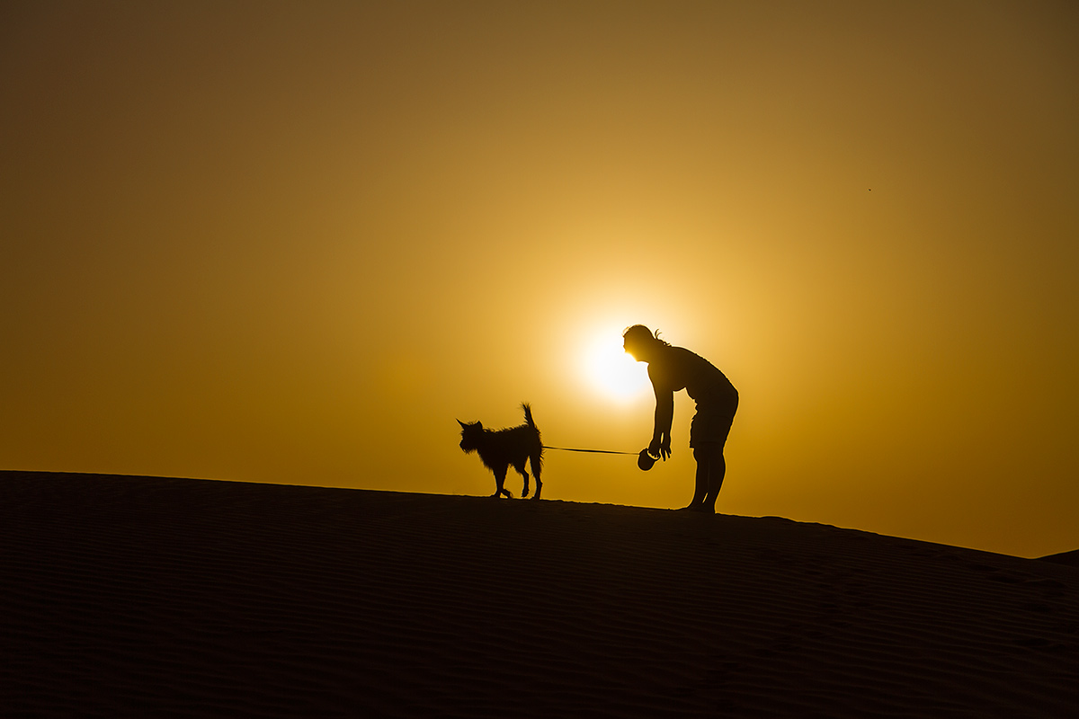 Polona and Punky on a dune. At sunset, of course.